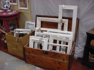 Trunk Filled With Distressed Picture Frames