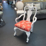 UPHOLSTERED ROLLING ARM CHAIR