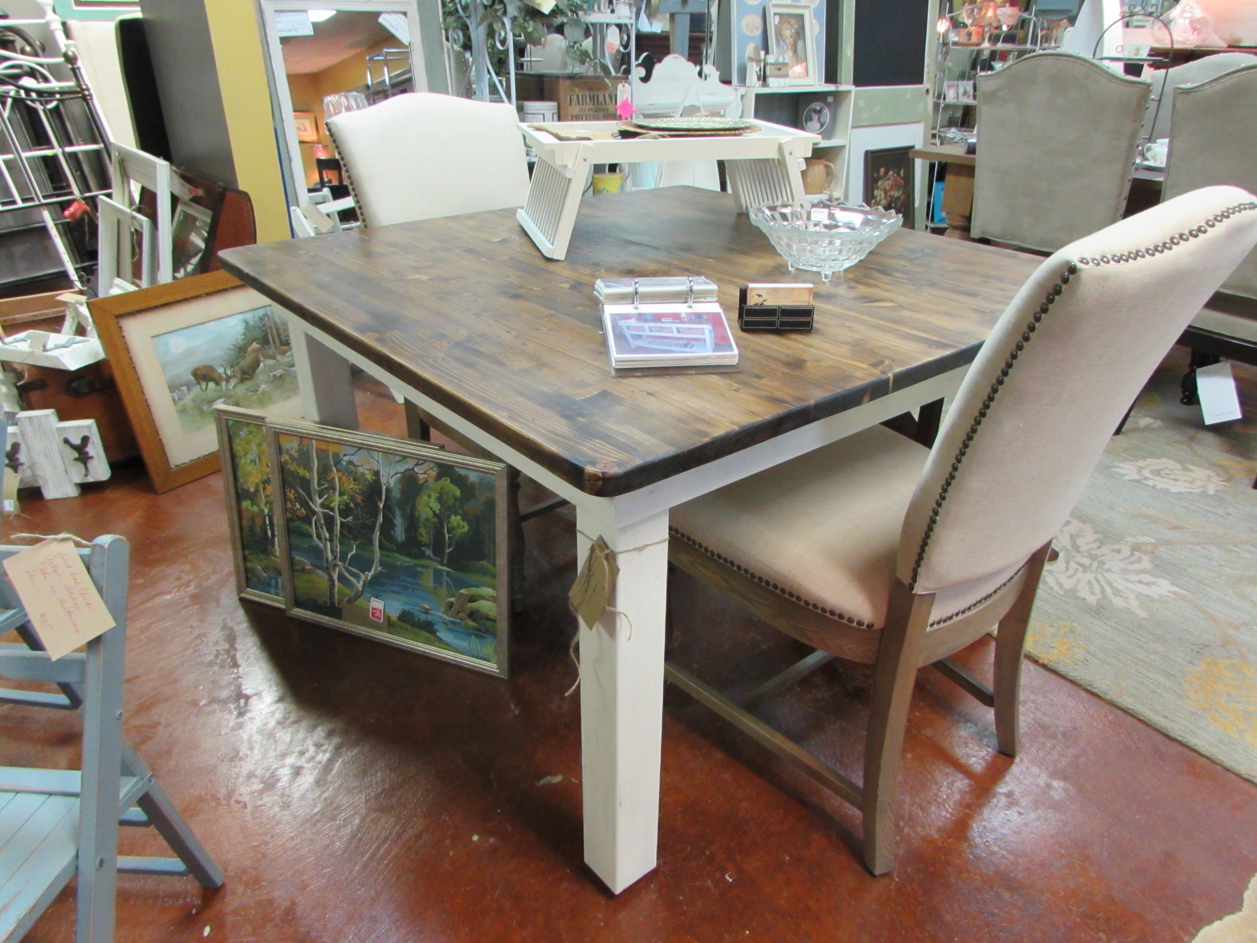 A DISTRESSED SQUARE FARMHOUSE TABLE & A DOOR CHALKBOARD
